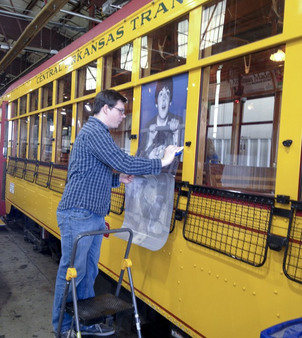 Installing Beatles window graphics on trolley